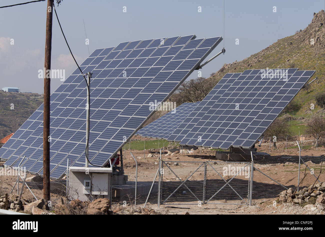 Solar energy panels in countryside, West Lesvos, Greece, march - Stock Image