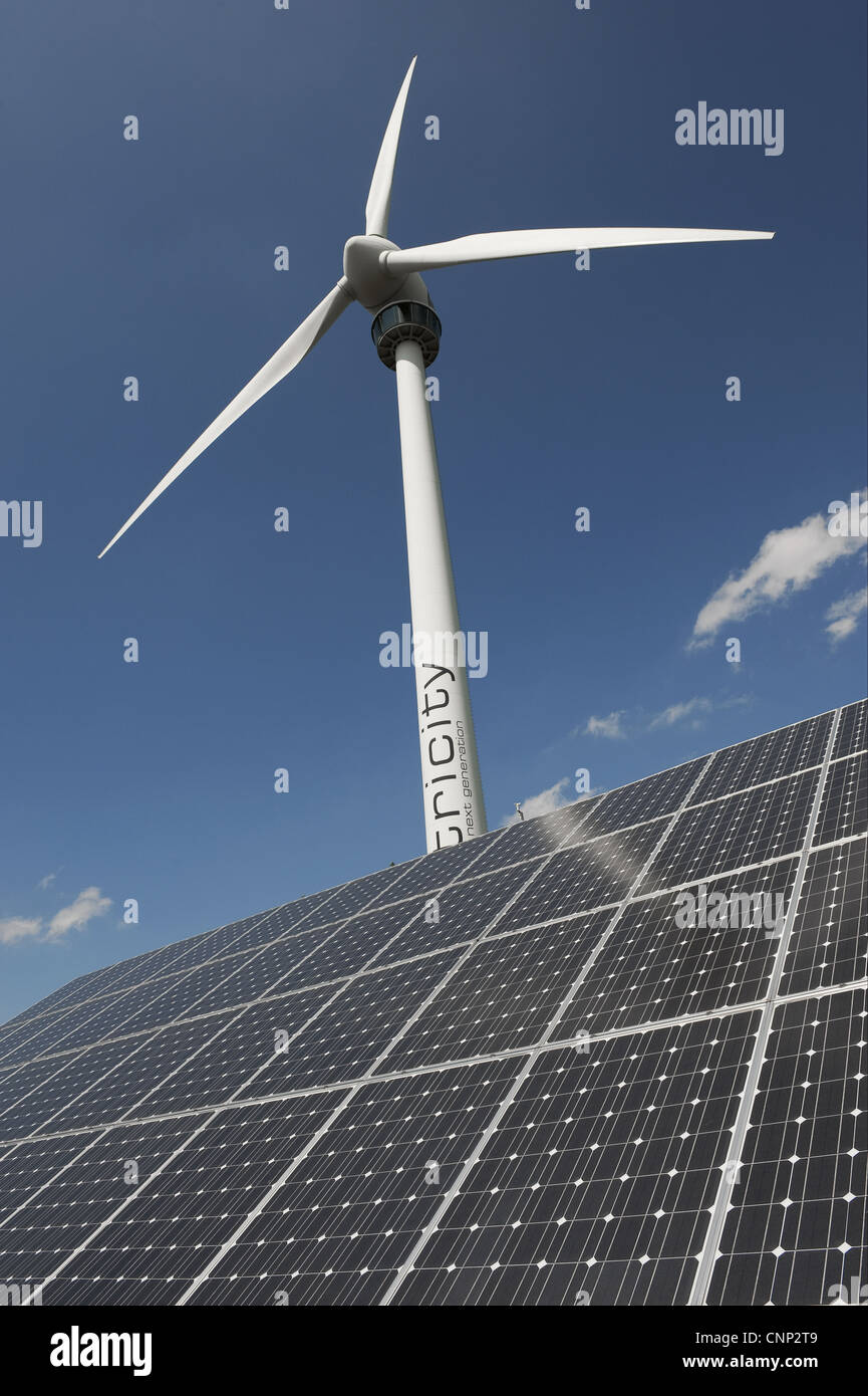 Wind turbine and solar panels at ecotech centre, Swaffham, Norfolk, England, august - Stock Image