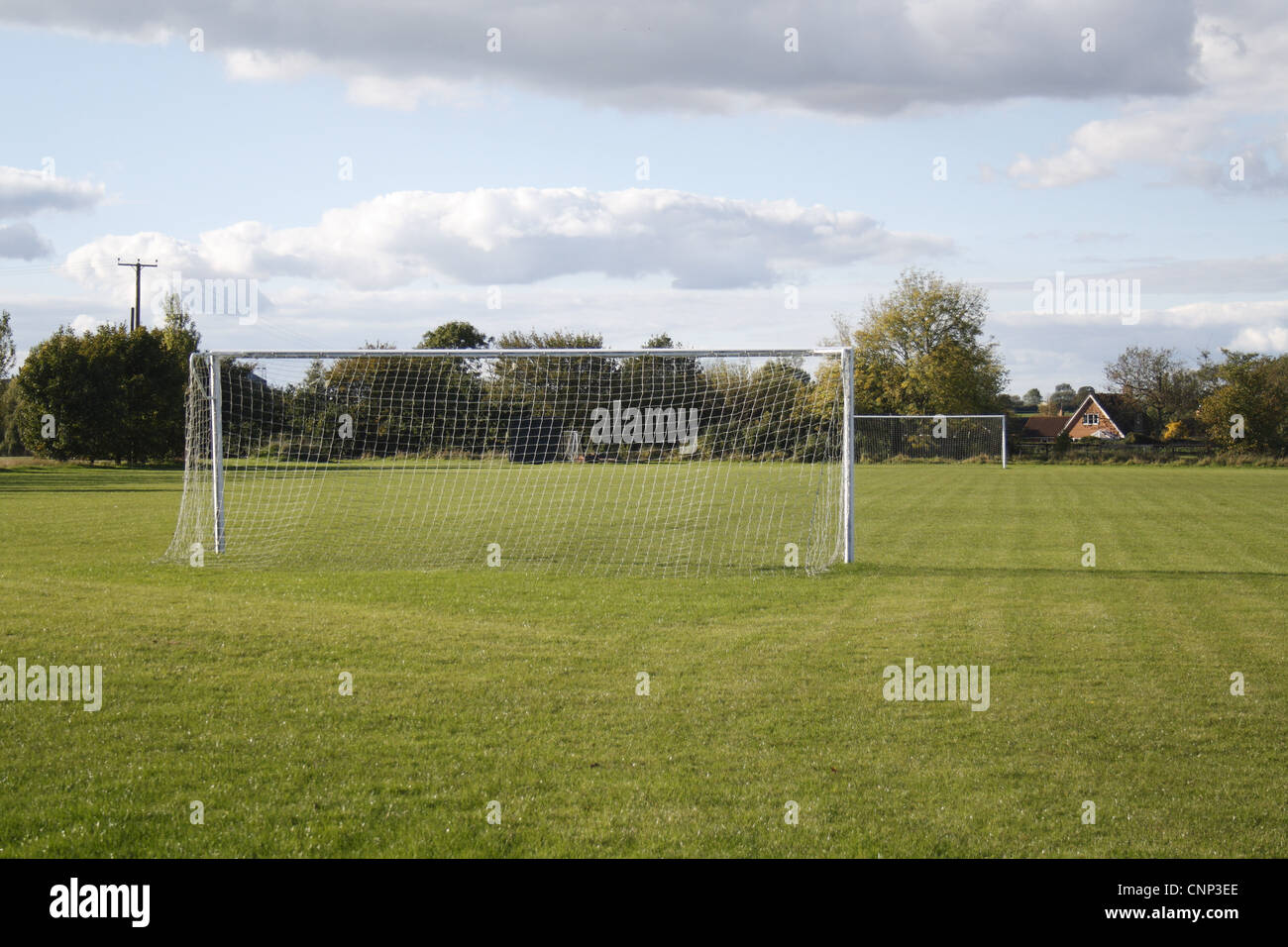 Goal posts on village football pitch, in evening sunshine, Bacton, Suffolk, England, october - Stock Image