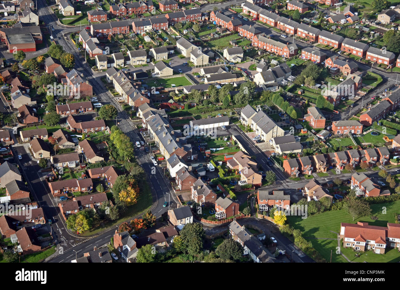 aerial view of affordable new homes built on a brown field site amongst existing older houses - Stock Image
