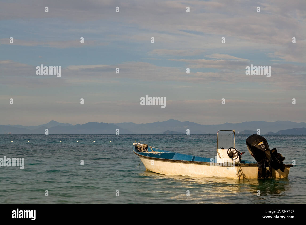 Anchored boat in the ocean - Stock Image