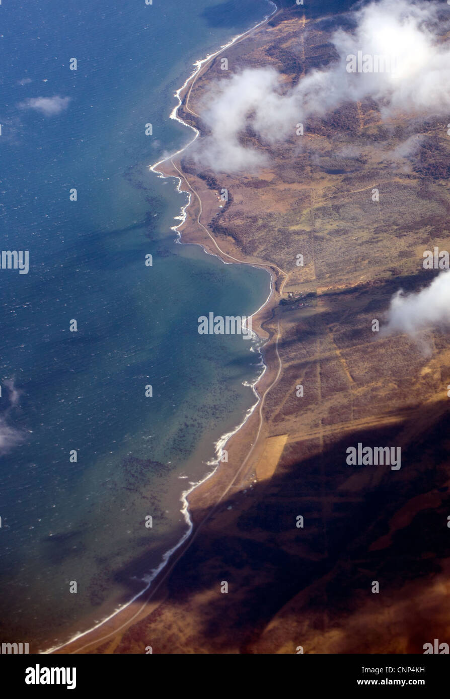 Aerial view of seacoast in south america resembling a human portrait outline - Stock Image