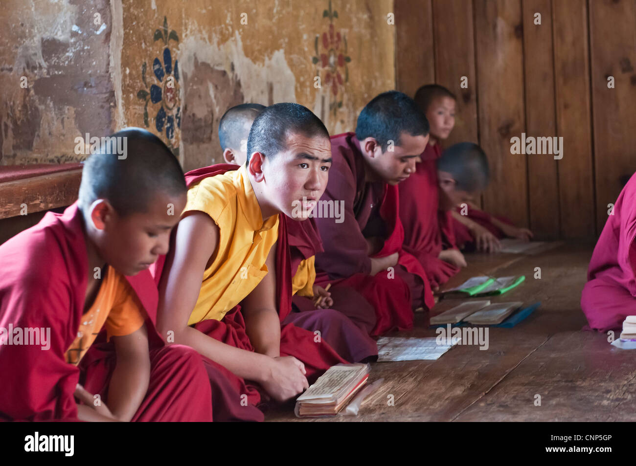 Asia, Bhutan. Young monks chanting in the Temple of the Divine Madman - Stock Image