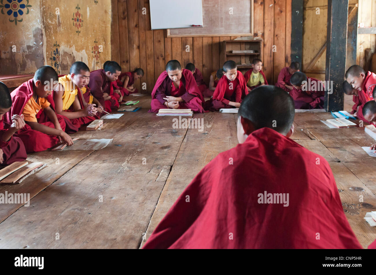 Asia, Bhutan. Young monks chanting in the Temple of the Divine Madman.  Credit as - Stock Image