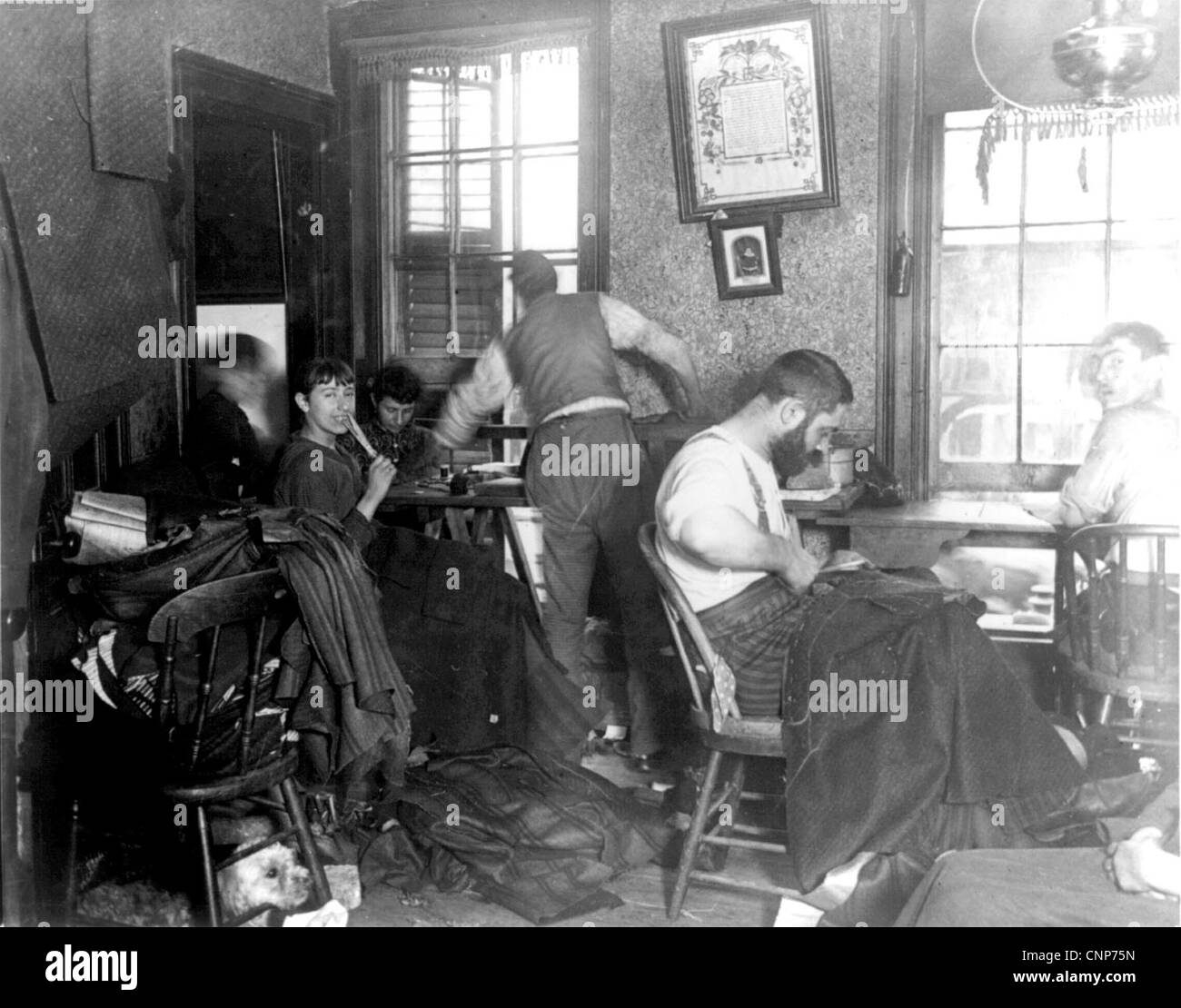 NEW YORK SWEATSHOP on Ludlow Road, NY, about 1905 - Stock Image