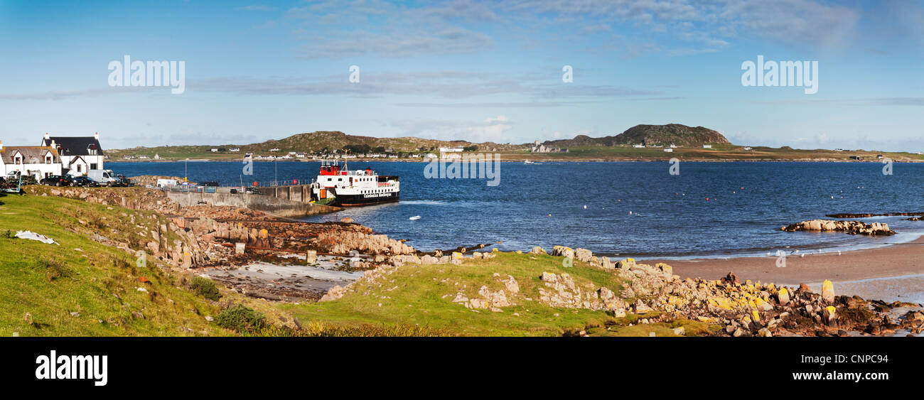 Panorama of ferry slip at Fionnphort, Isle of Mull, looking across the Sound of Iona to the island of Iona. - Stock Image