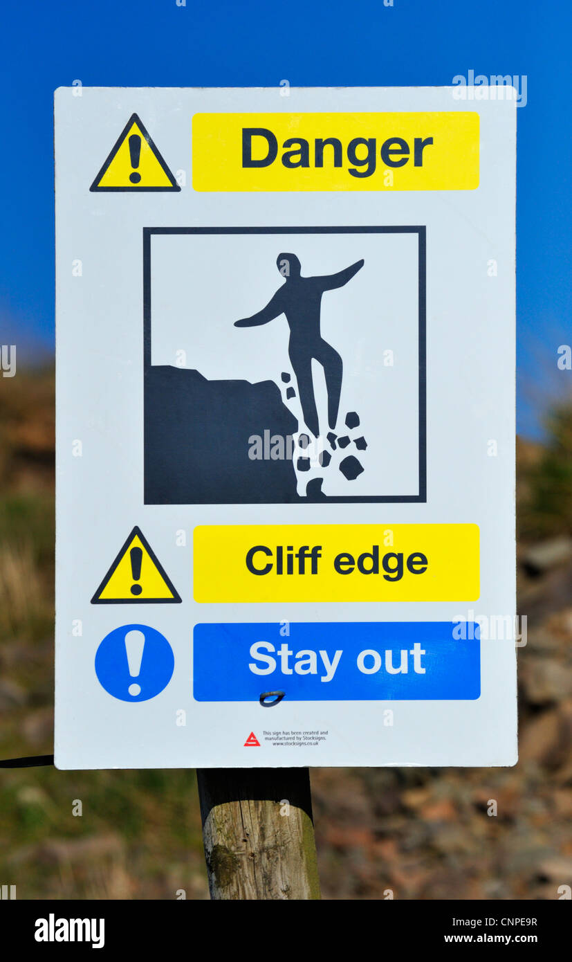 'Danger. Cliff edge. Stay out', notice at Roan Edge Quarry. New Hutton, Cumbria, England United Kingdom, - Stock Image