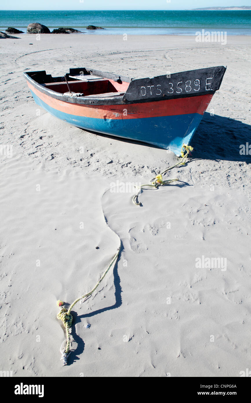Colorful fishing boat on Paternoster Beach Western Cape South Africa - Stock Image