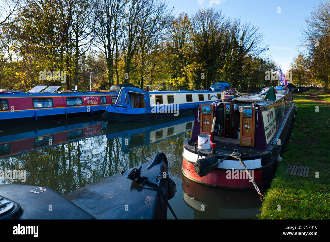 Canal boats on the Grand Union Canal near to Milton Keynes, UK. - Stock Image