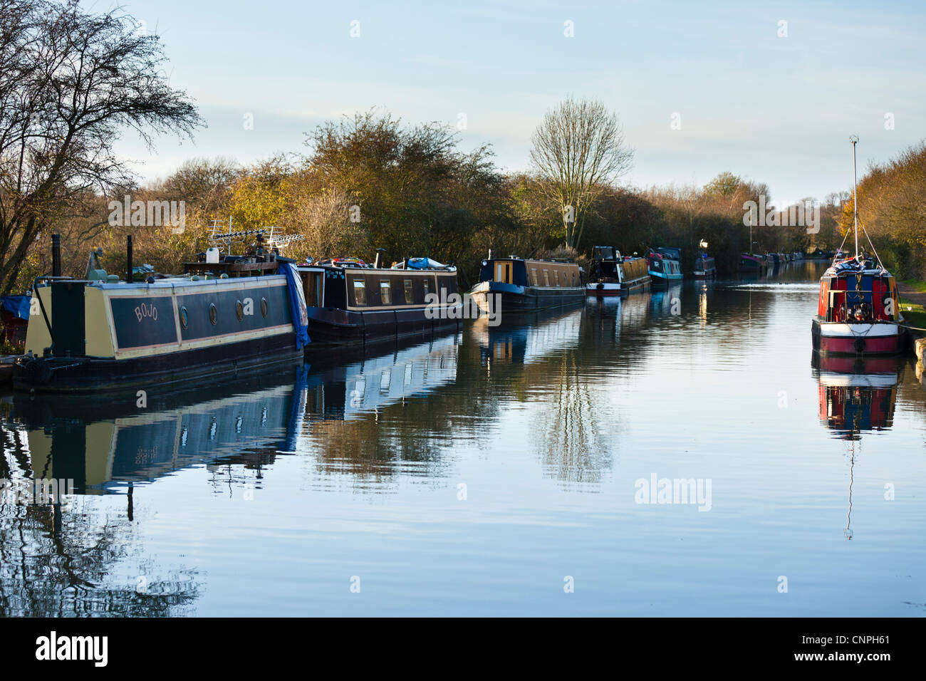 Canal boats moored on the Grand Union Canal near to Milton Keynes, UK. - Stock Image