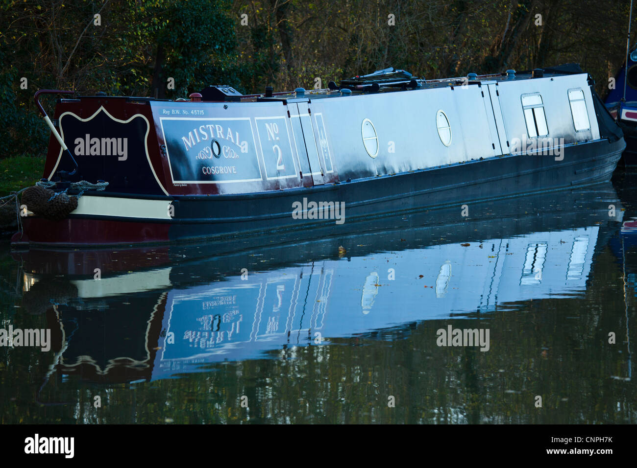 A canal boat moored on the Grand Union Canal near to Milton Keynes, UK. - Stock Image