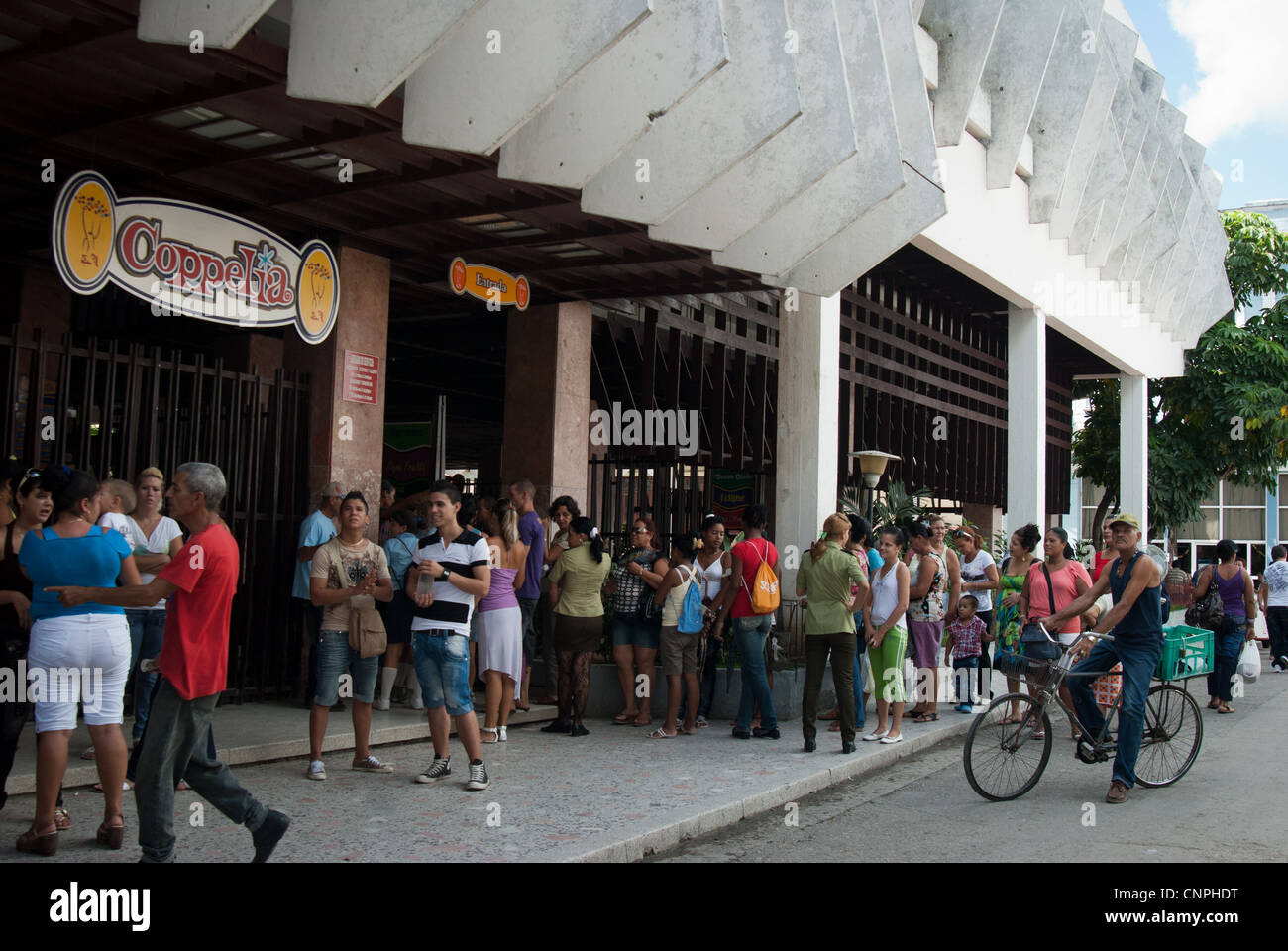 Long cue outside Coppelia. It is a favorite place for Cubans to hang out for hours and enjoying cheap delicious - Stock Image