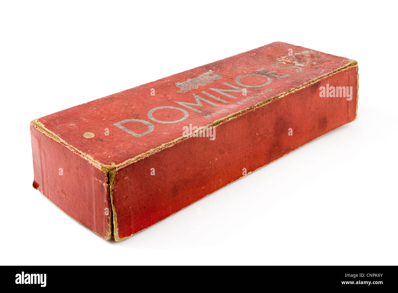 Old carboard dominos box over white - Stock Image