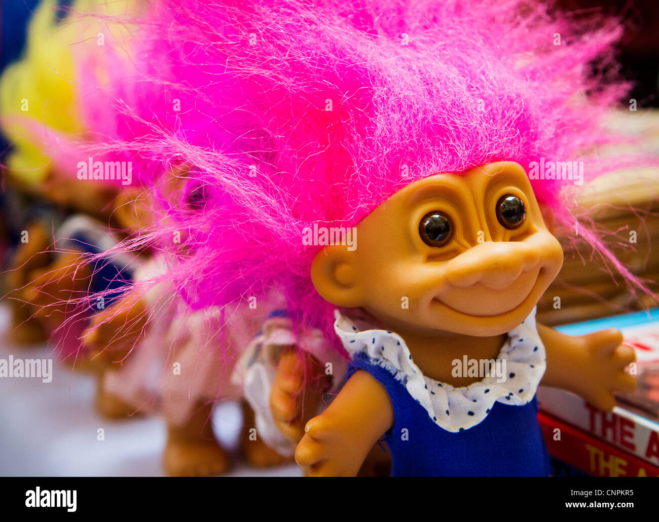 colorful troll dolls on sale in an antique market at warrington