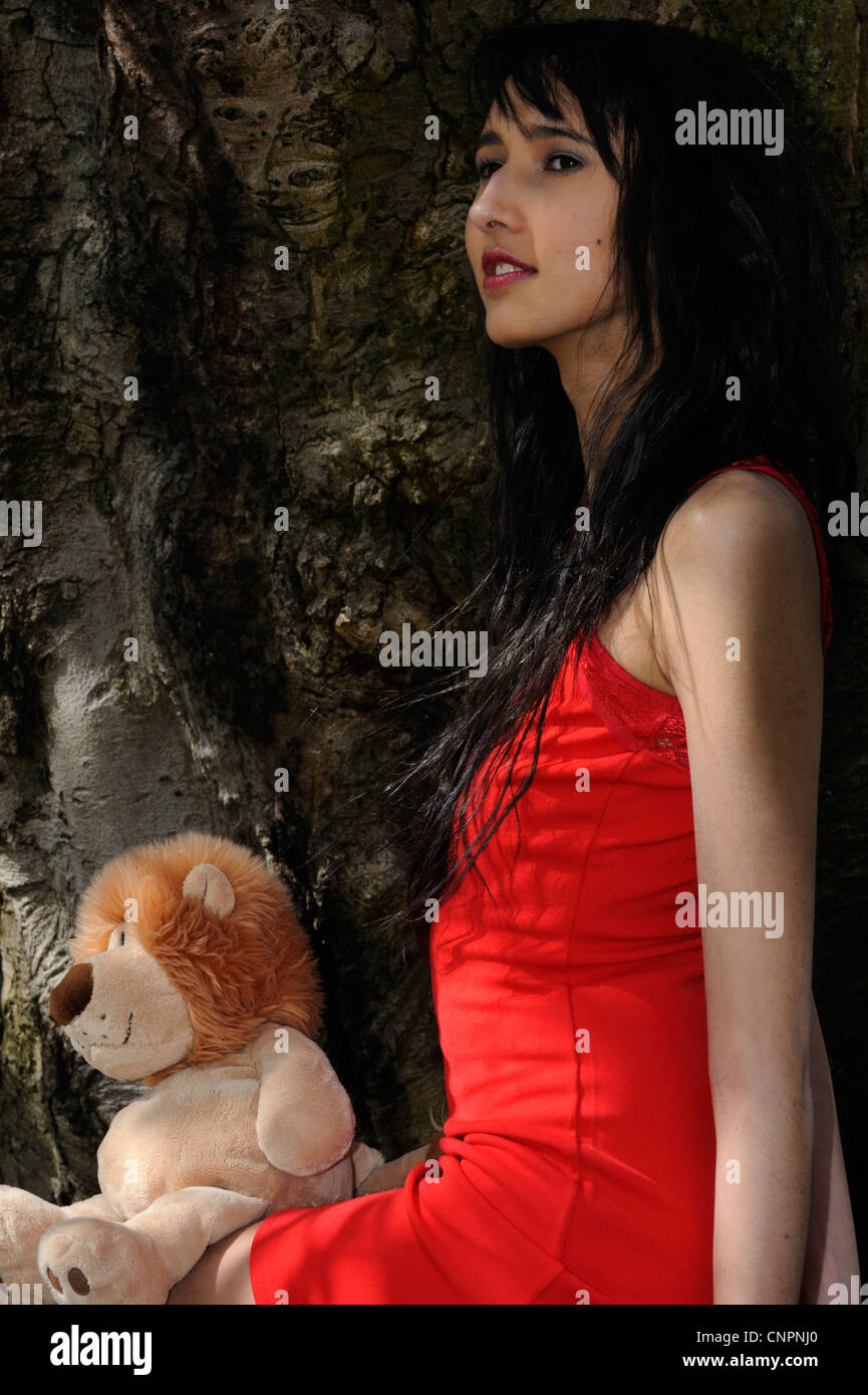 5cc62cc4492 Fashion model 'Kittiwara' in a red Cassie Lace Bodycon Dress by BooHoo -  Stock