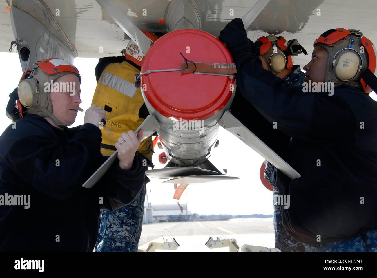 NAVAL AIR FACILITY MISAWA, Japan (April 21, 2012) – Aviation Ordnanceman team, attached to Patrol Squadron (VP) Stock Photo
