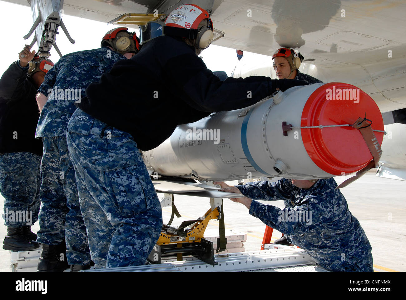 Aviation Ordnanceman team, attached to Patrol Squadron (VP) 1, downloads the SLAM-ER (Captive Air Training Missile) - Stock Image