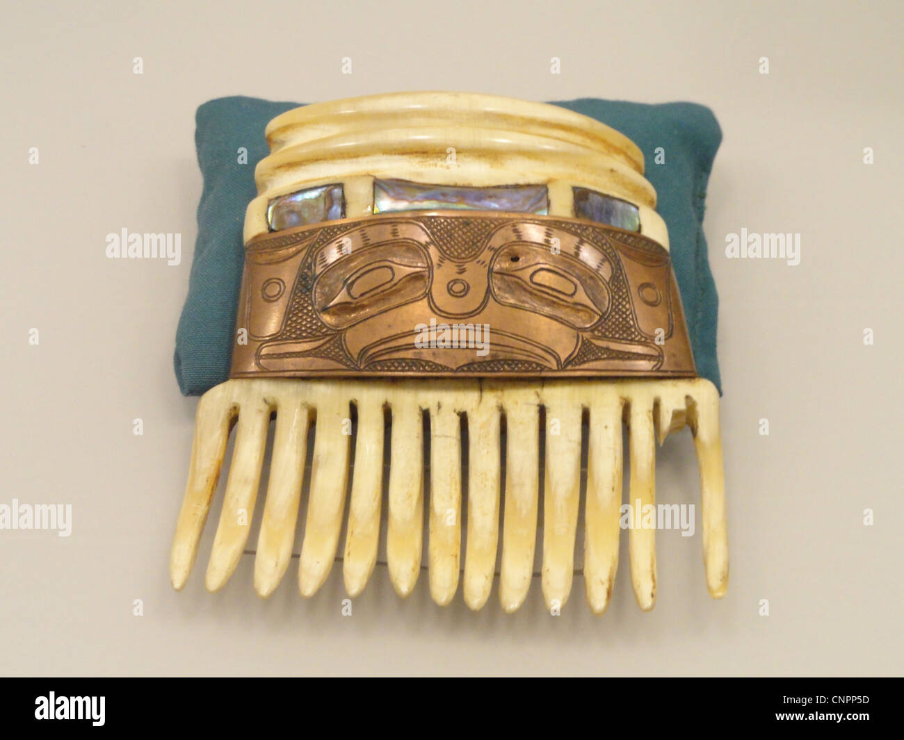 Comb, Haida or Tlingit, carved ivory with copper and shell - Native American collection - Peabody Museum, Harvard - Stock Image