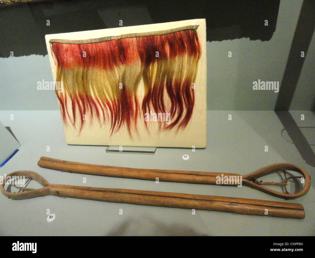 Collar (top), Choctaw, dyed horsehair, before 1828; ball sticks (Cherokee), collected on Qualla Reservation, 1907 Stock Photo
