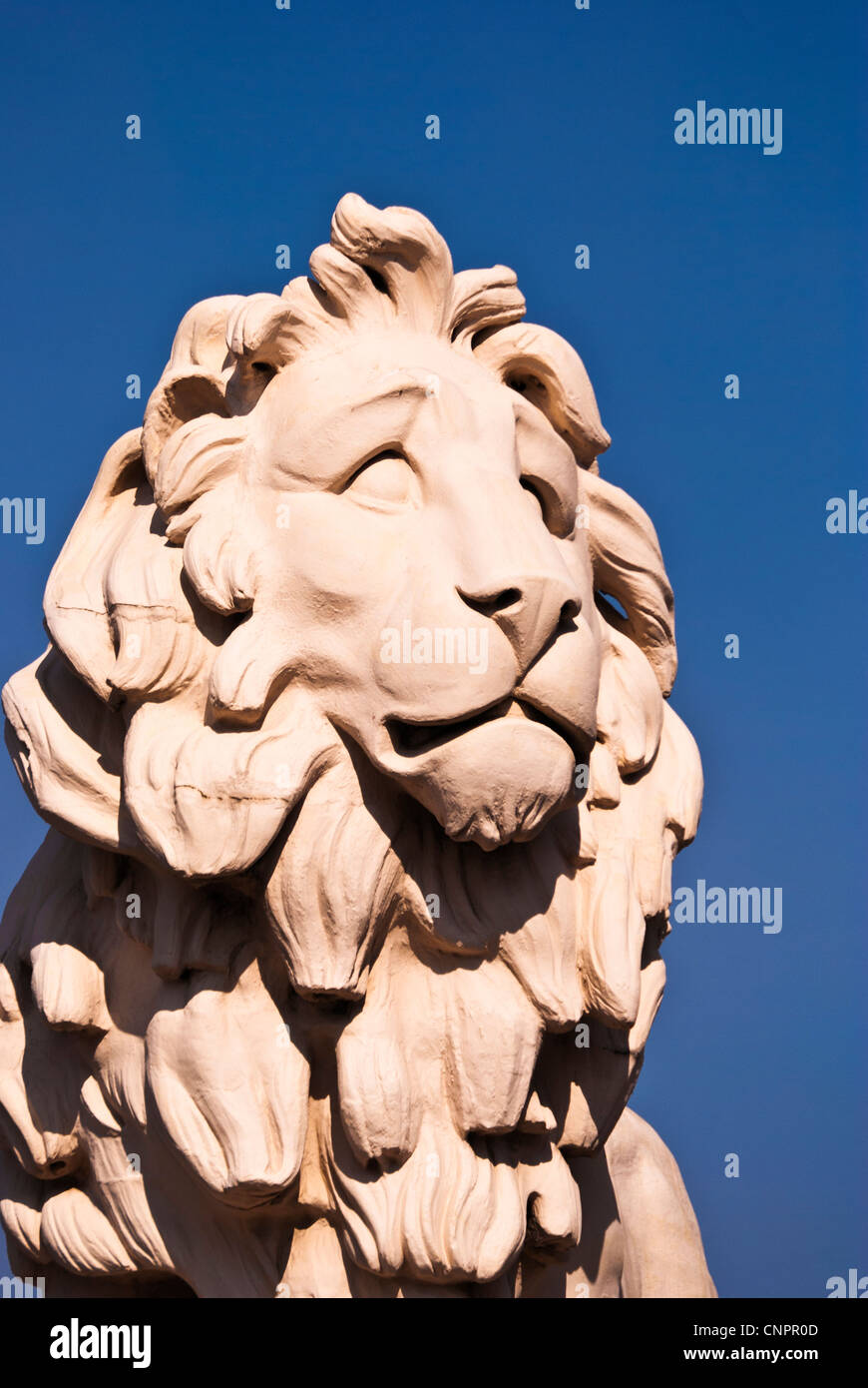 A stone lion on Westminster Bridge, London, England, UK - Stock Image