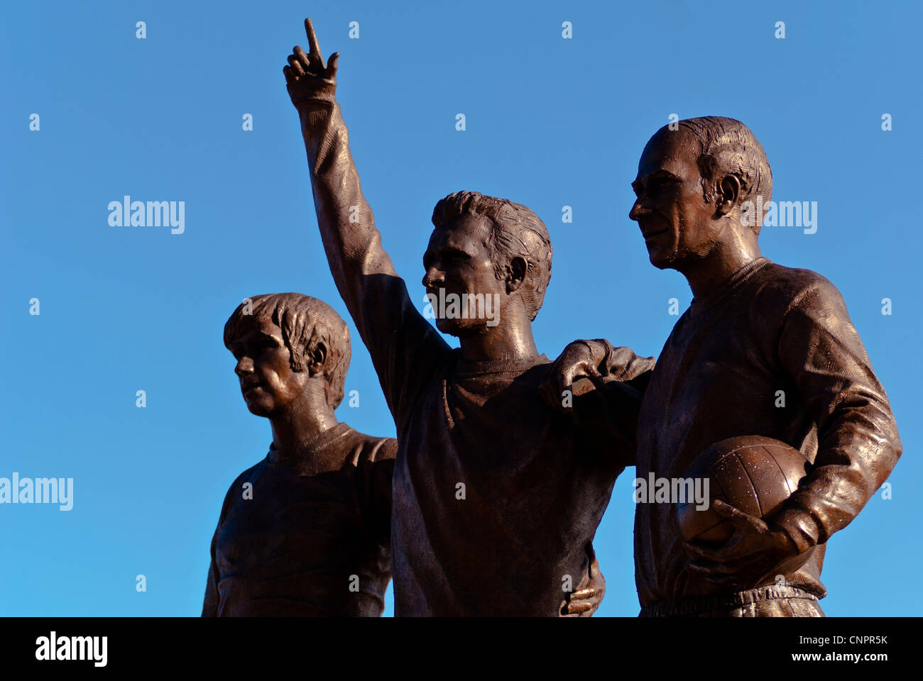 The United Trinity outside Manchester United ground of Best, Law and Charlton, Manchester, England, UK - Stock Image