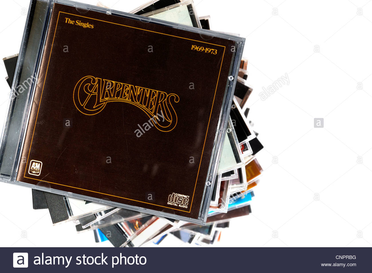 The Carpenters album The Singles 1969-1973, piled music CD cases, England. Stock Photo