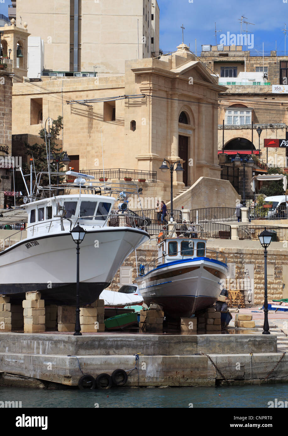 Fishing boats being repaired  Spinola Bay St Julian's Malta, Europe - Stock Image