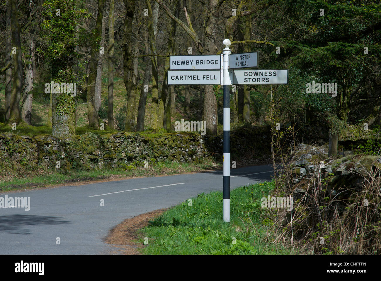 Old-fashioned signpost at a road junction, Ludderburn, Lake District National Park, Cumbria, England uk - Stock Image