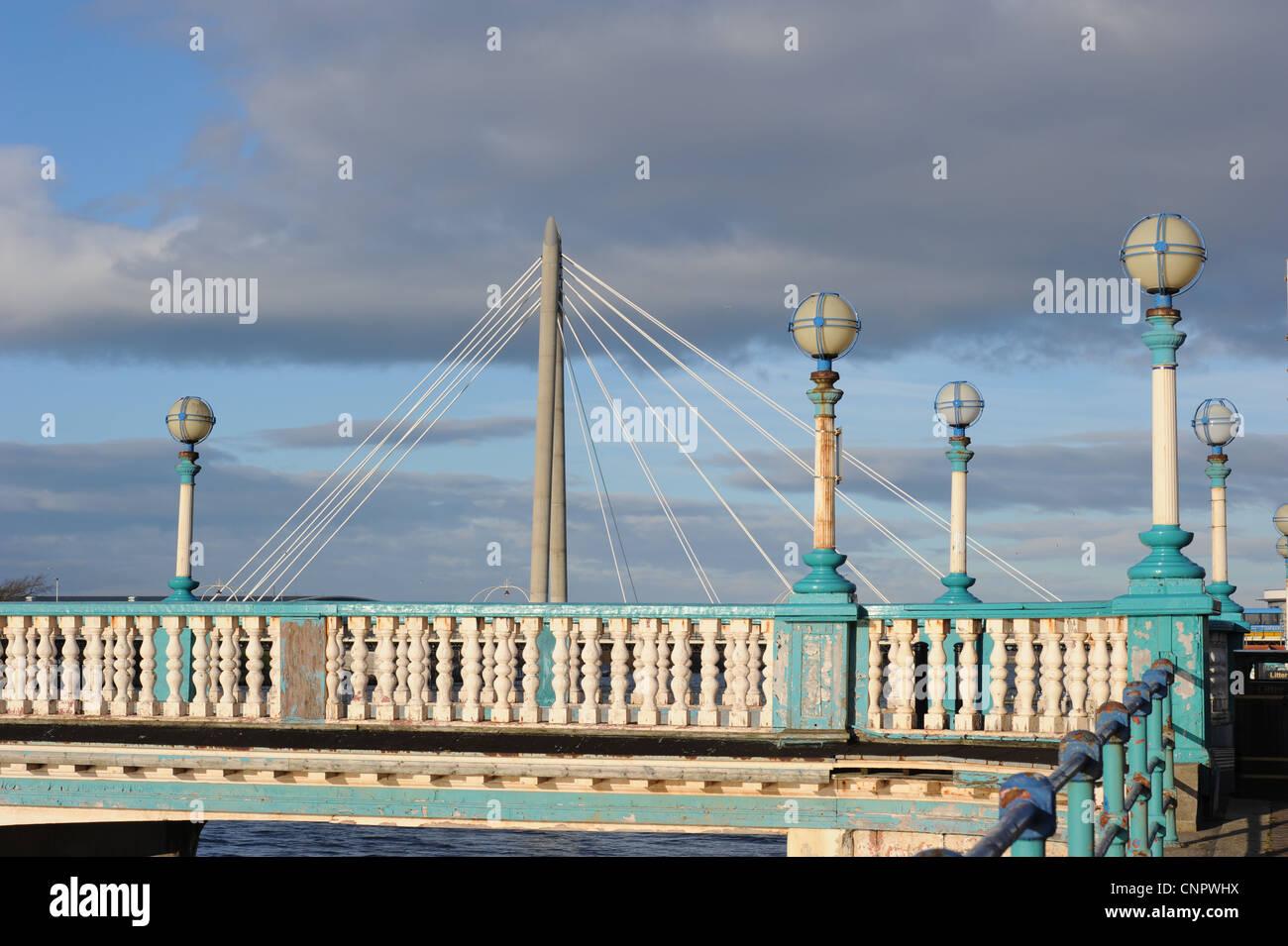 Old Scarisbrick Avenue Bridge over Marine Lake, Southport. Merseyside, with modern Marine Way cable stayed bridge - Stock Image