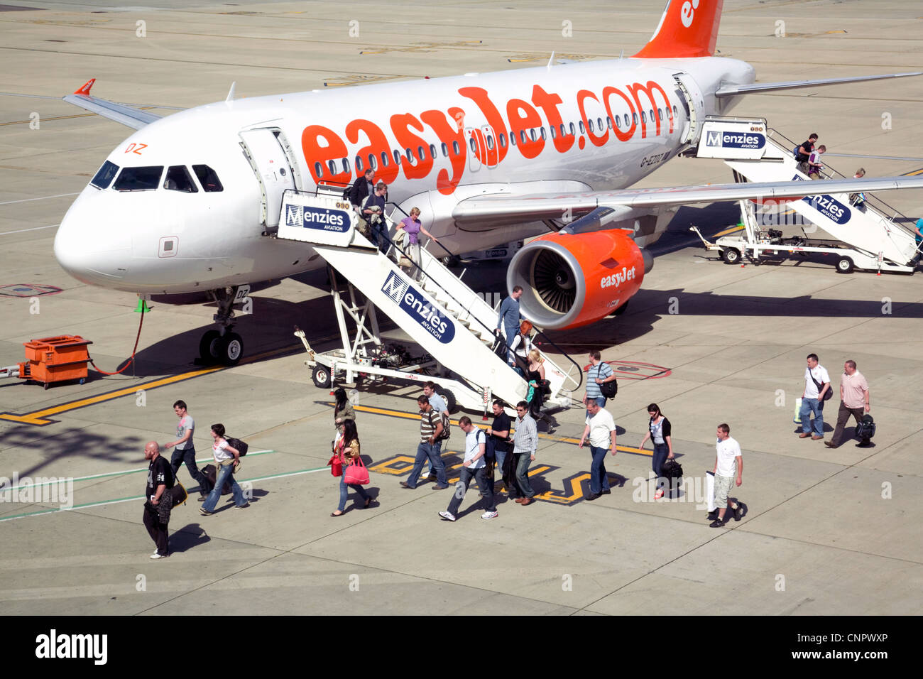 Passengers boarding an Easyjet plane, Stansted airport Essex UK - Stock Image
