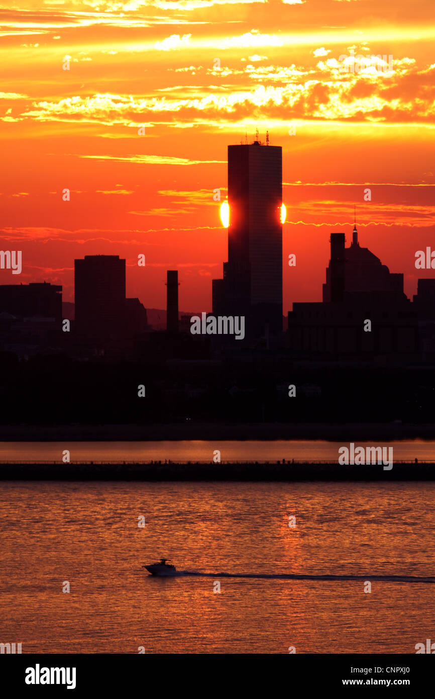 Setting Sun Eclipsed by the John Hancock Tower - Stock Image