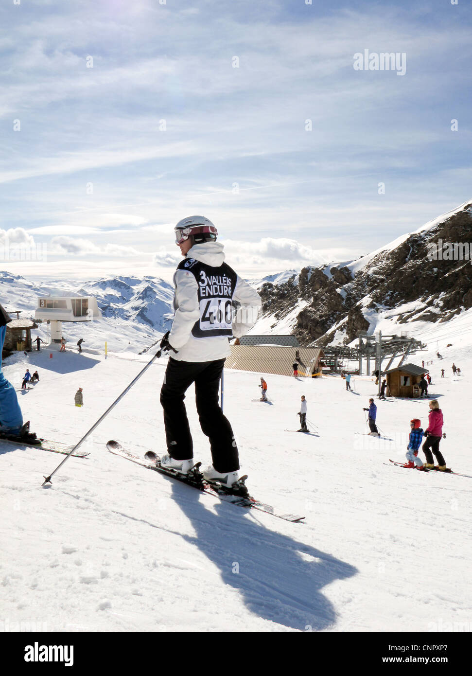 A skier skiing in the Three Valleys ski slopes, French Alps, France Europe - Stock Image