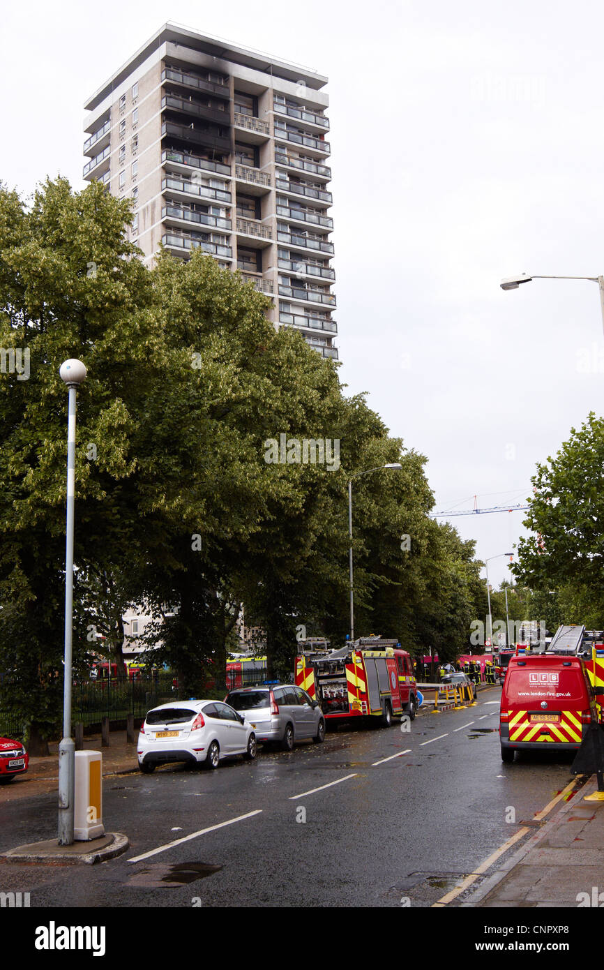 Emergency services attend a tower block fire in Abbey Street, Bermondsey caused by a faulty Beko fridge freezer - Stock Image