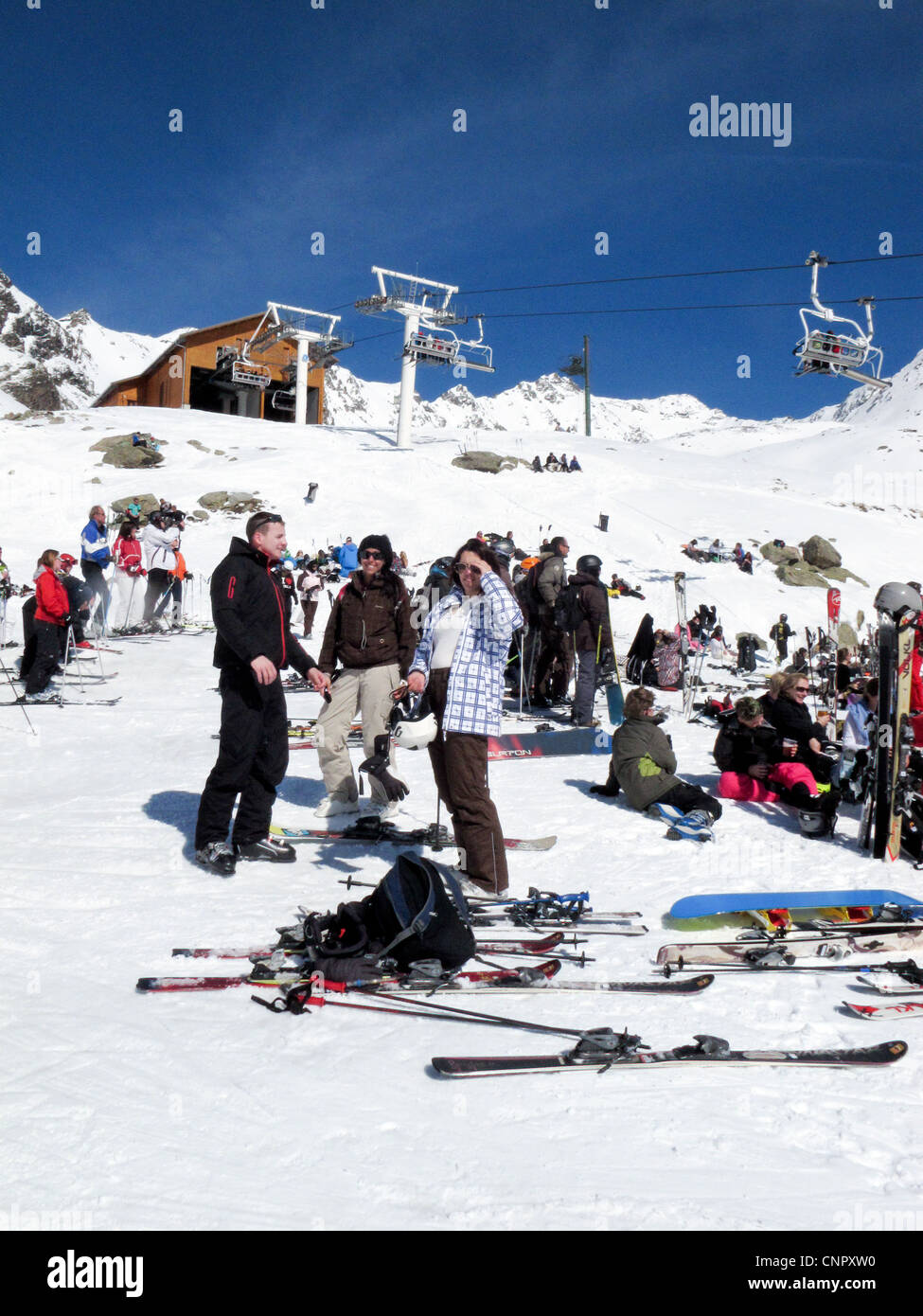 France skiing - Skiers getting ready to go on the ski lifts, Val Thorens, Three Valleys French alps, France Europe - Stock Image