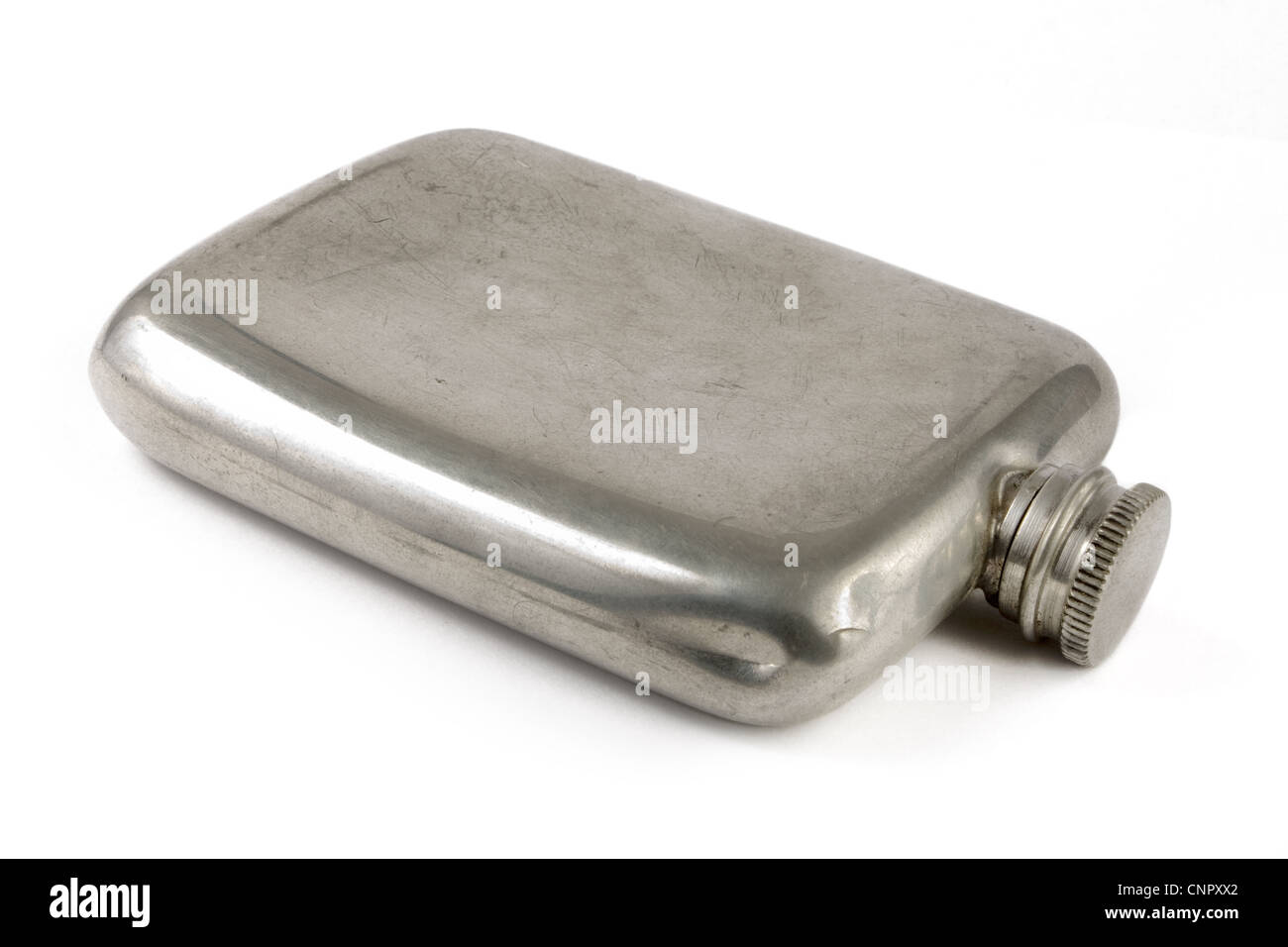 Aged silver hip flask over white - Stock Image
