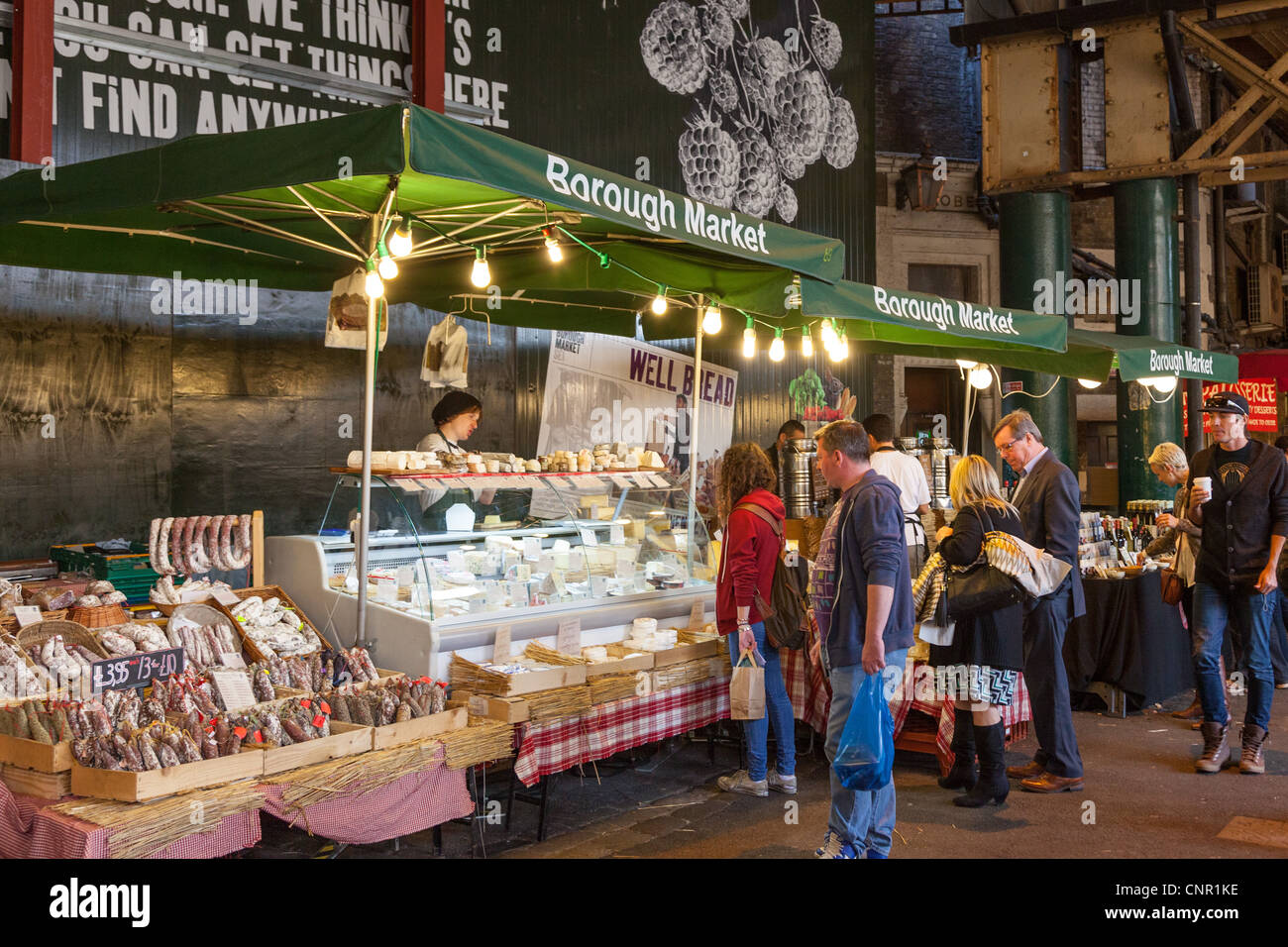 People shopping at Borough Market London England - Stock Image