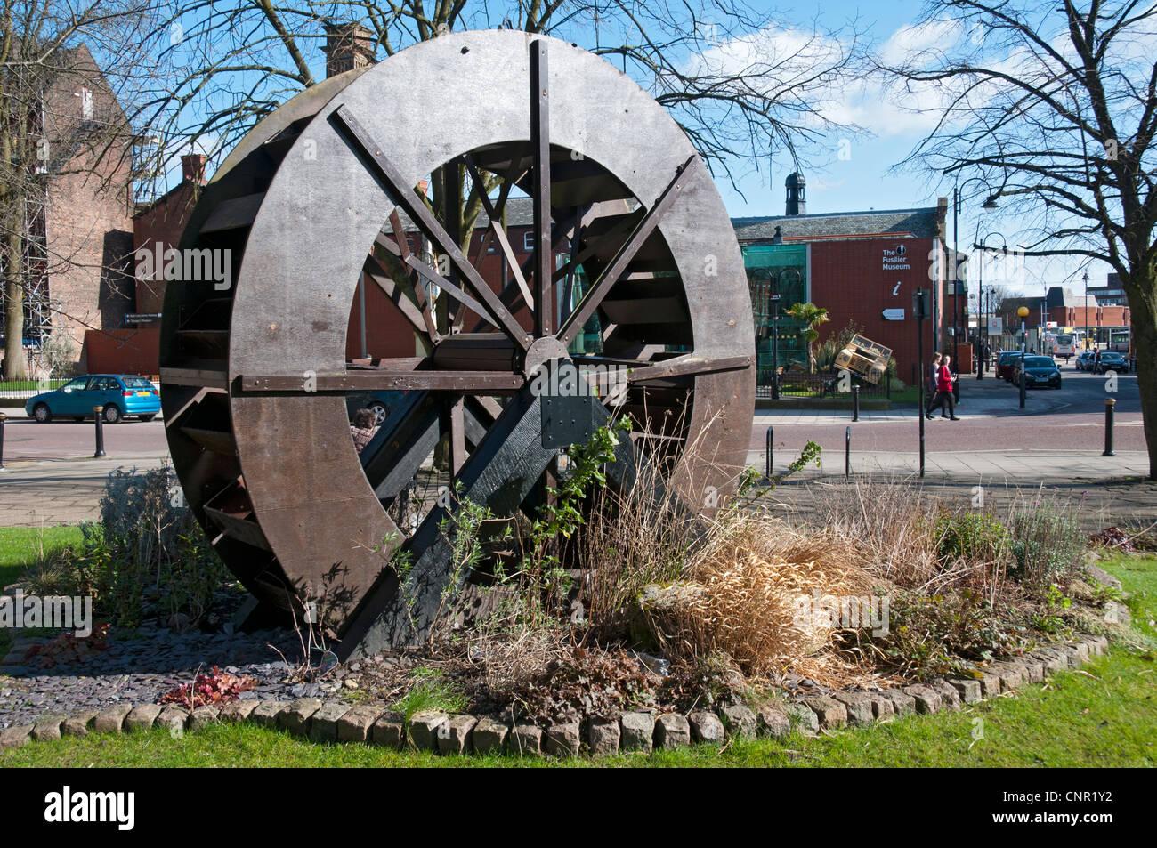 Imitation waterwheel in public gardens on Silver Street, Bury, Greater Manchester, England, UK - Stock Image