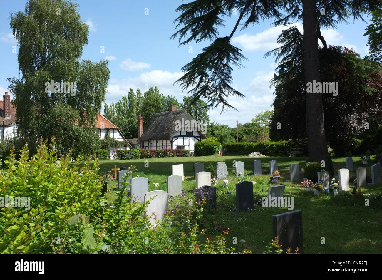 Churchyard and Thatched Cottage in East Hendred, Oxfordshire - Stock Image
