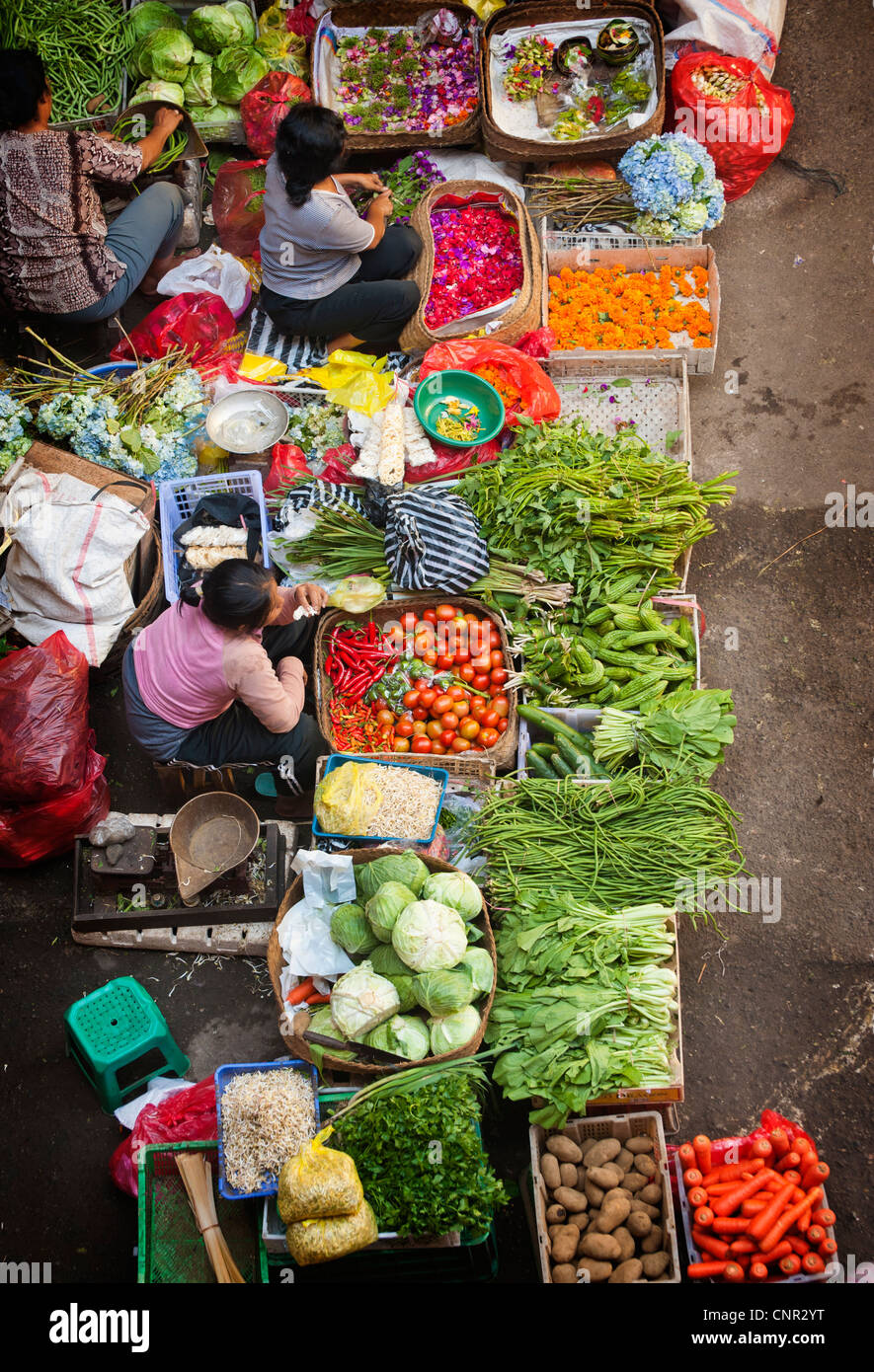 Early every morning fruit and vegetable sellers gather at the Ubud, Bali public market located on the main street, - Stock Image