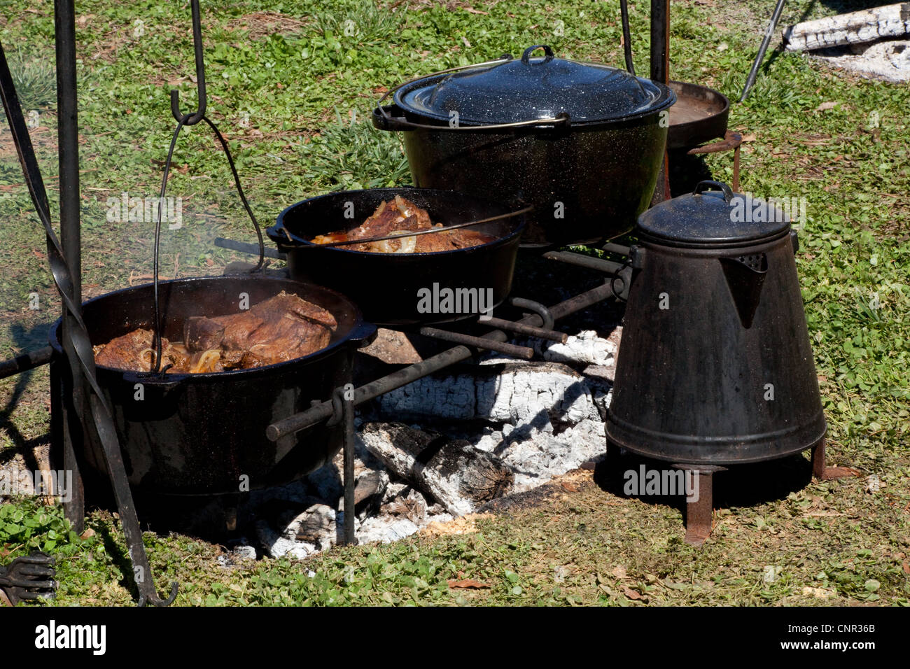 cast iron cooking pots over stock photos cast iron cooking pots over stock images alamy. Black Bedroom Furniture Sets. Home Design Ideas