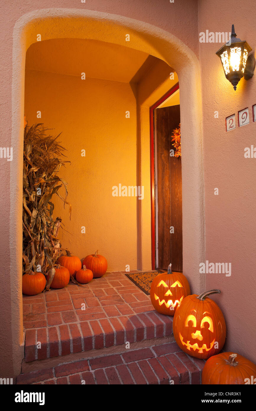 House entryway with Halloween Jack-O-Lantern Pumpkins - Stock Image