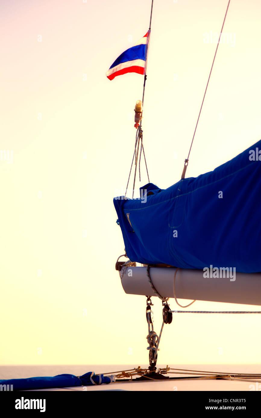 Sailing under Thai flag - Stock Image