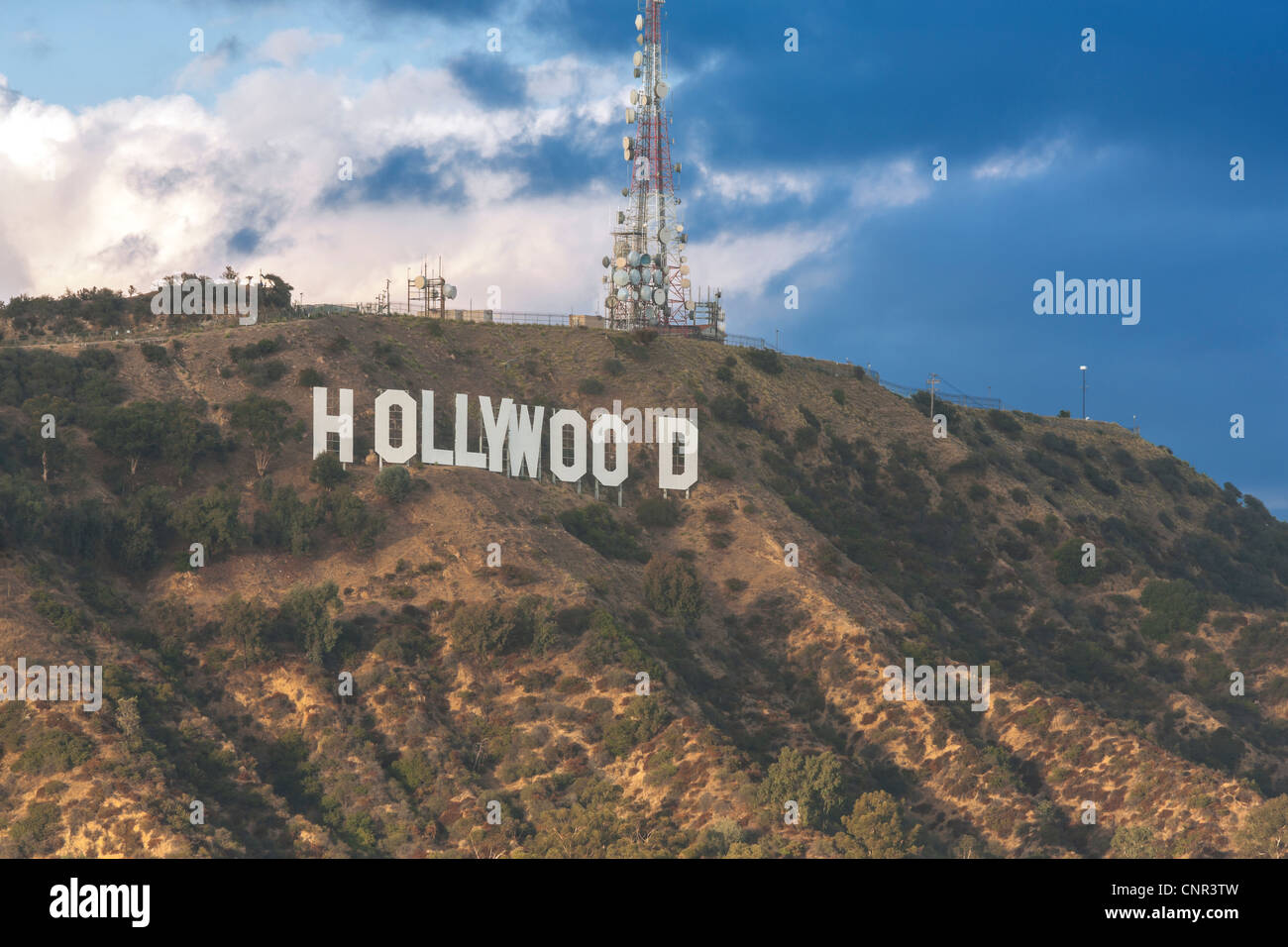 The Hollywood Sign under dark storm rain clouds. In the Hollywood Hills, Los Angeles, California CA US USA LA L.A.. - Stock Image