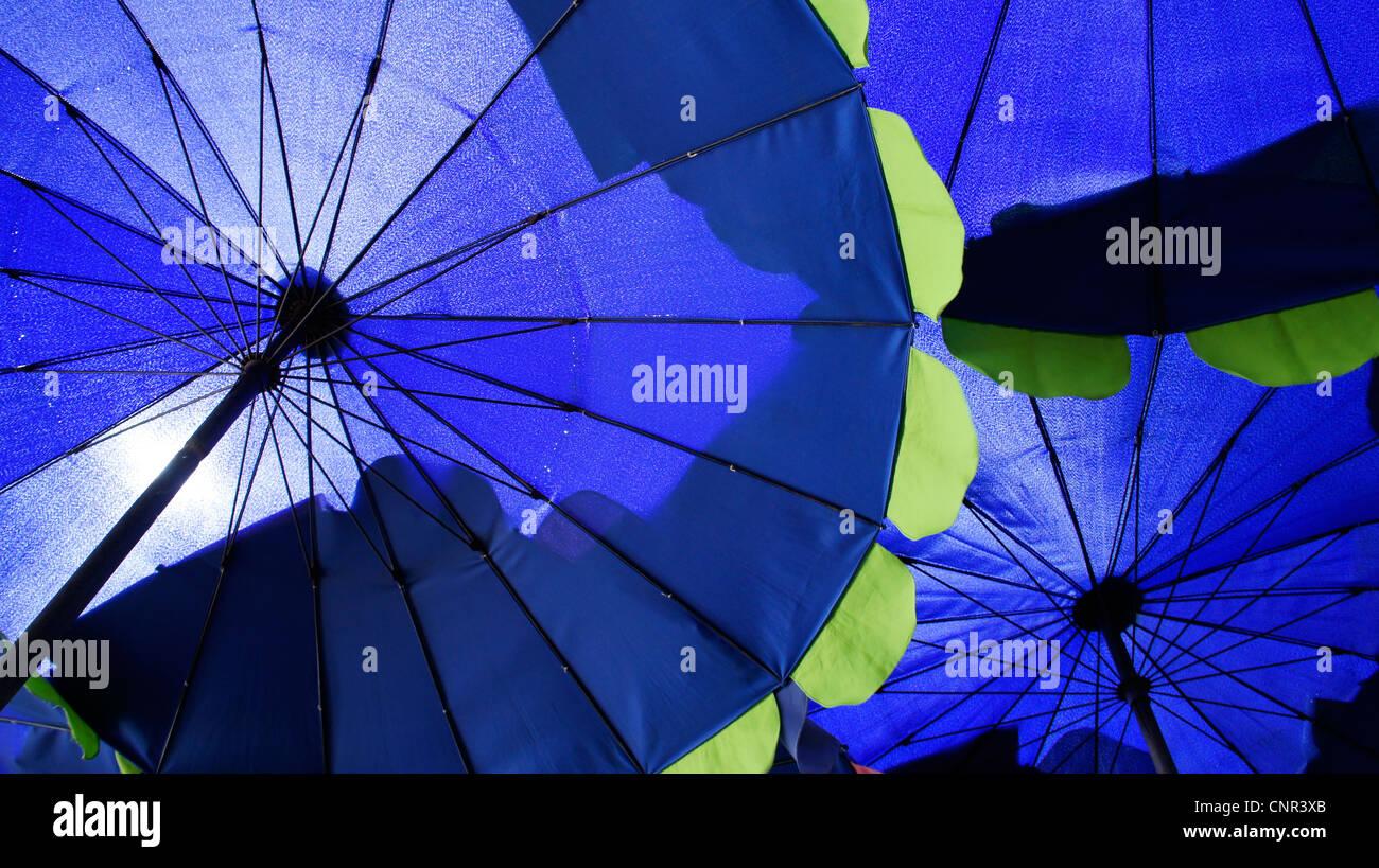 lose up of blue umbrellas background - Stock Image