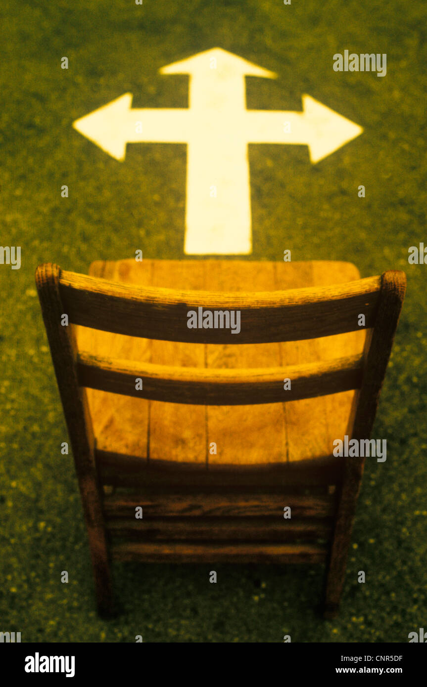 Empty Wooden Chair and Arrow - Stock Image
