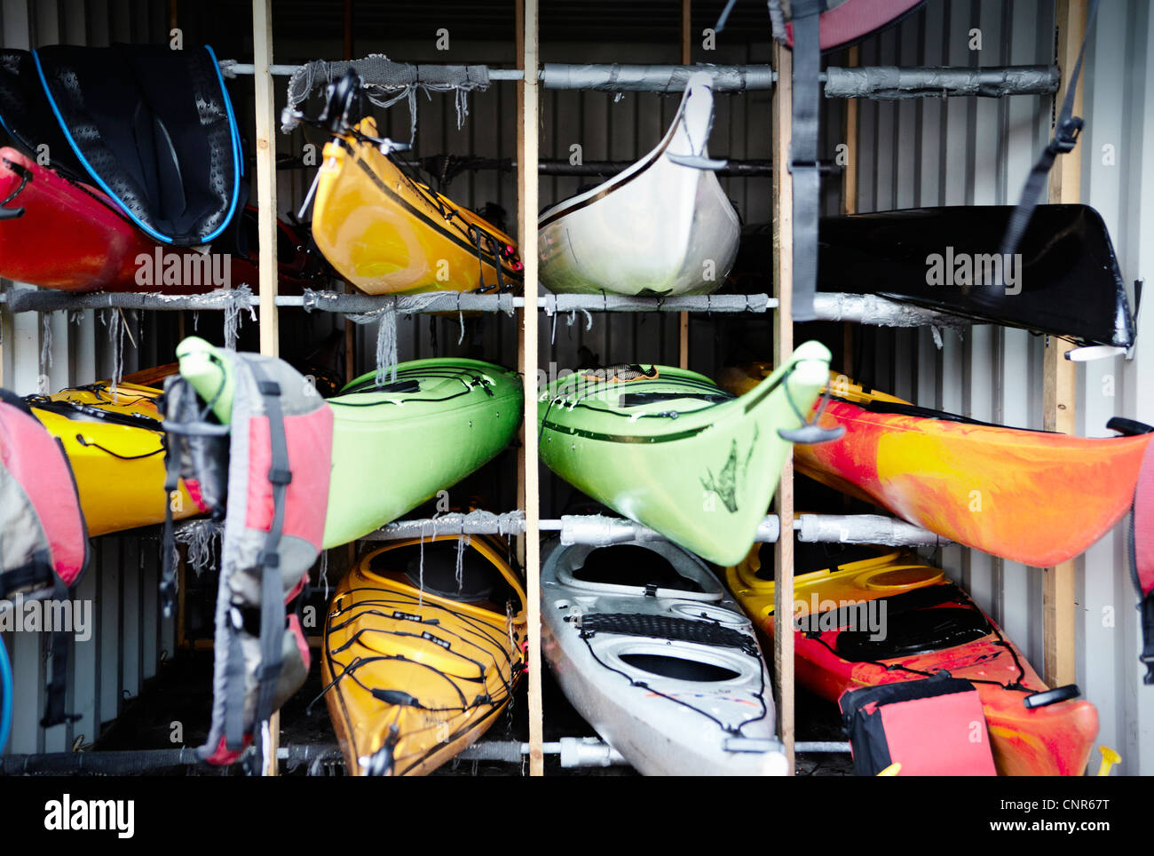 Kayaks stacked in cubes - Stock Image