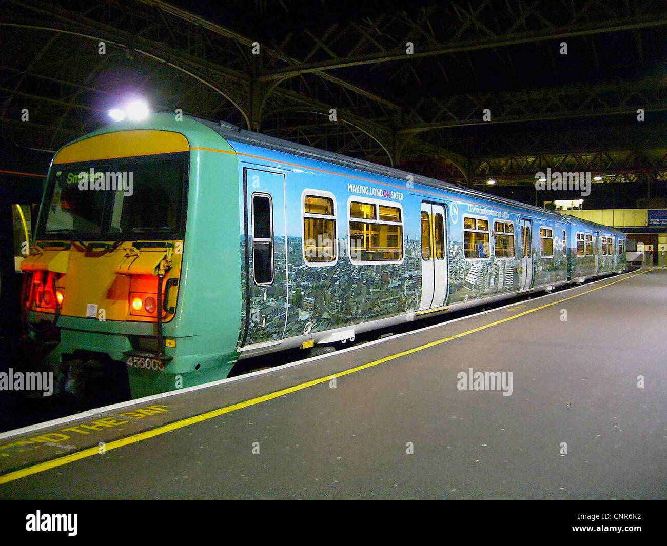 The joint Southern/TfL CCTV advertising livery on Southern Metro Class 456 No. 456006 at London Bridge - Stock Image