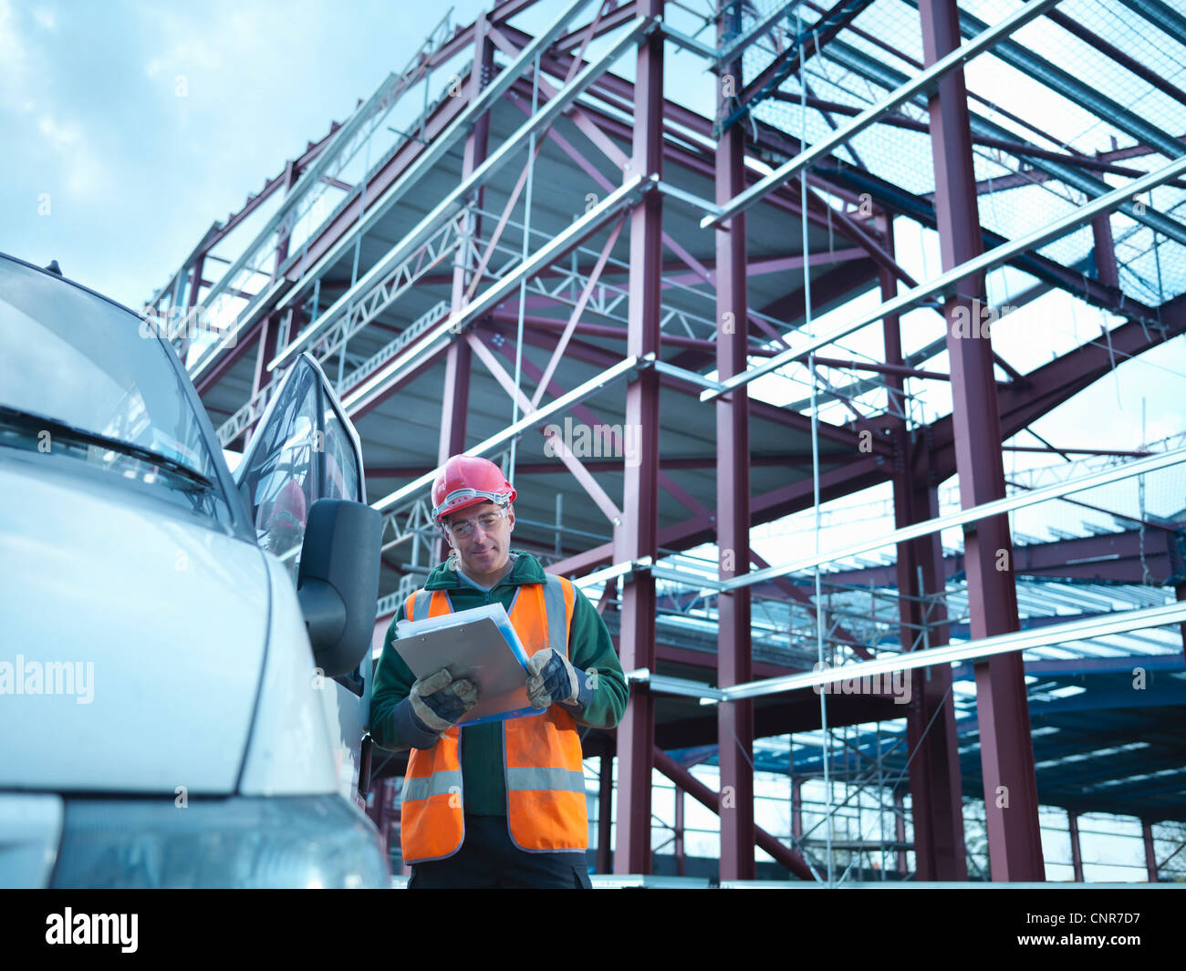 Construction worker reading clipboard Stock Photo