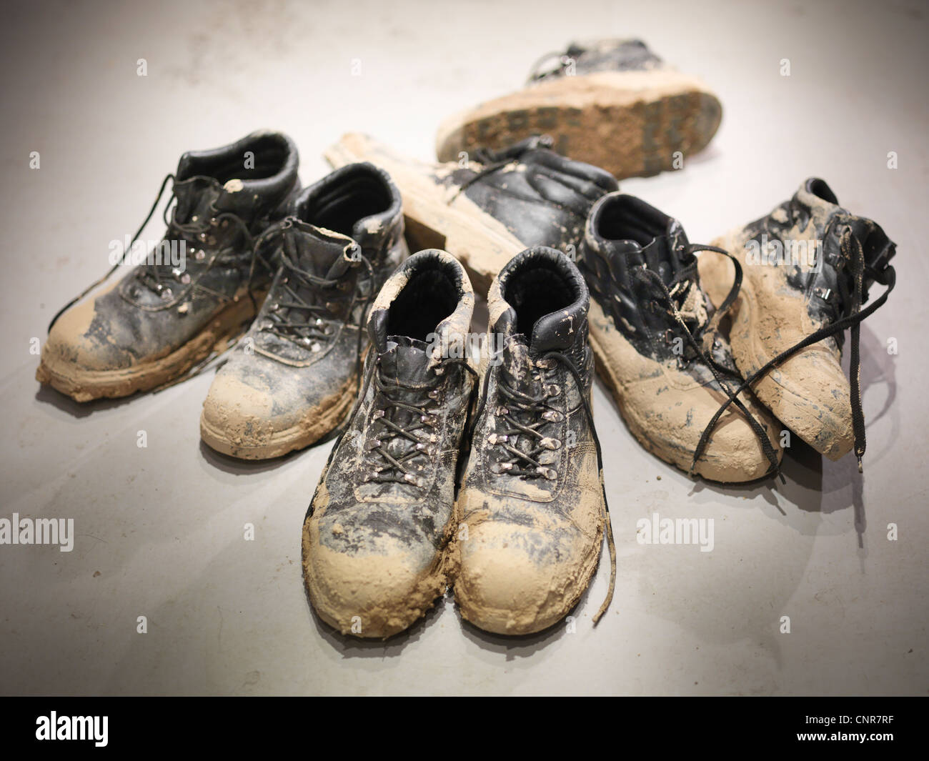 Close up of muddy work boots - Stock Image