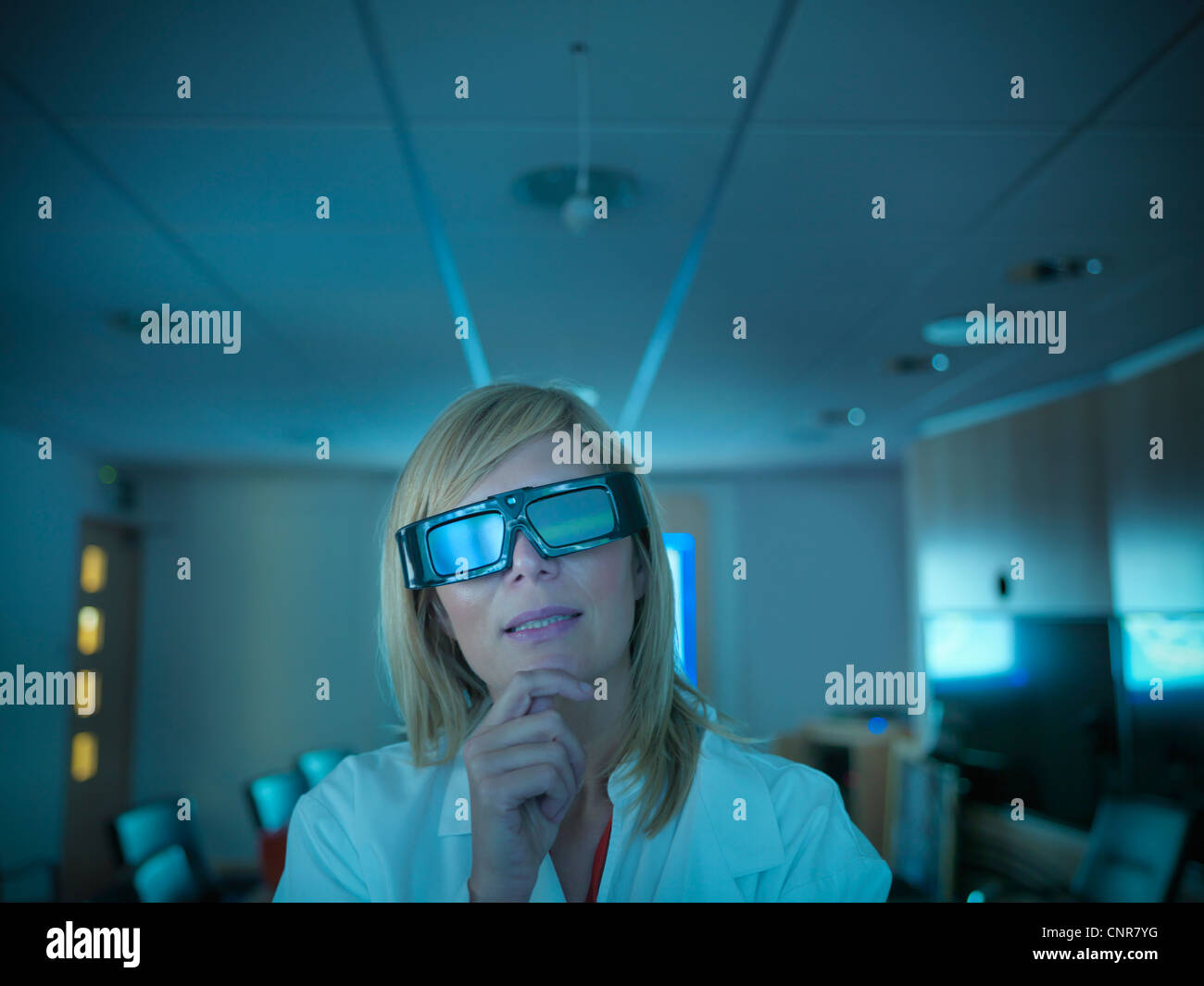 Scientist wearing 3D glasses in lab Stock Photo